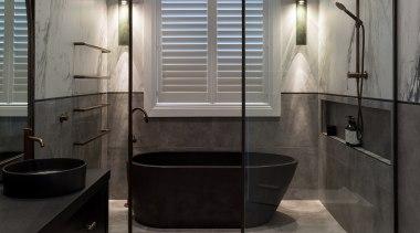 To create an open spacious feel, this bathroom