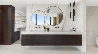 This glamorous ensuite was designed with a layout