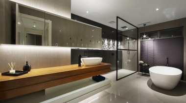 A large freestanding bath sits adjacent to the