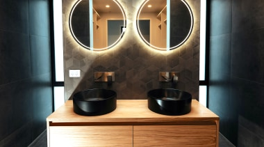 Modern and moody, this ensuite is a sanctuary