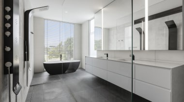 In this bathroom, subtle surface tones contrast with