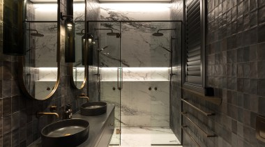 In a transitional villa renovation, a fifth bedroom
