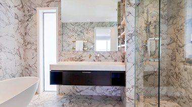A small partition wall between the shower and
