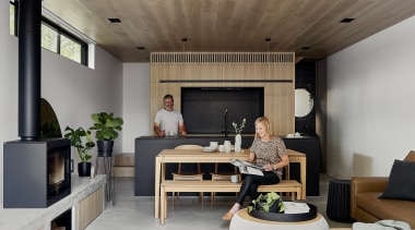 A wooden table, wooden bench seating and a