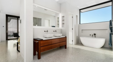 The main ensuite takes cues from this home's