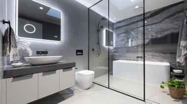 A large walk-in shower, big bath tub, good