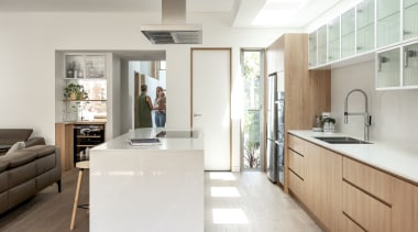 Natural light floods this new kitchen via a