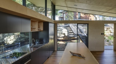 This kitchen, at the entry to the house, architecture, building, ceiling, concrete, countertop, daylighting, design, floor, flooring, furniture, glass, home, house, interior design, living room, loft, property, real estate, room, window, brown, gray