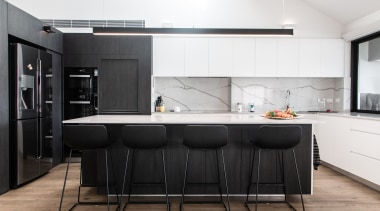 This kitchen is U-shaped in plan, with a architecture, black-and-white, building, cabinetry, ceiling, countertop, cupboard, design, dining room, floor, flooring, furniture, home, house, interior design, kitchen, kitchen stove, loft, material property, property, real estate, room, table, white, black