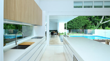 In this kitchen, there is a seamless transition apartment, architecture, building, ceiling, daylighting, design, floor, furniture, home, house, interior design, property, real estate, room, window, white