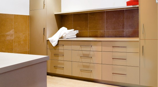 View of laundry featuring cabinetry from Splendor Kitchens. cabinetry, countertop, cuisine classique, floor, flooring, hardwood, interior design, kitchen, laminate flooring, plywood, property, real estate, room, tile, wood, wood flooring, white