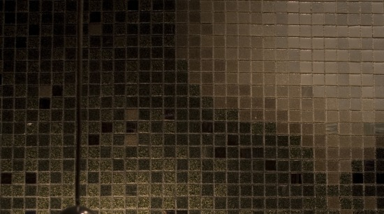 View of a powder room which features a ceiling, floor, flooring, light, light fixture, lighting, tile, wall, brown, black