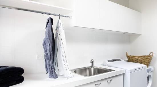 View of a laundry which was added to countertop, floor, furniture, interior design, kitchen, laundry room, product design, room, white, gray