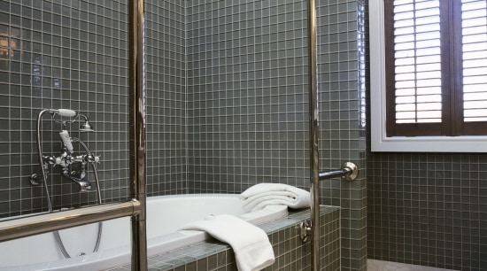 View of bath with glass wall tiles, chrome bathroom, floor, interior design, plumbing fixture, room, tile, wall, window, window covering, window treatment, black, gray