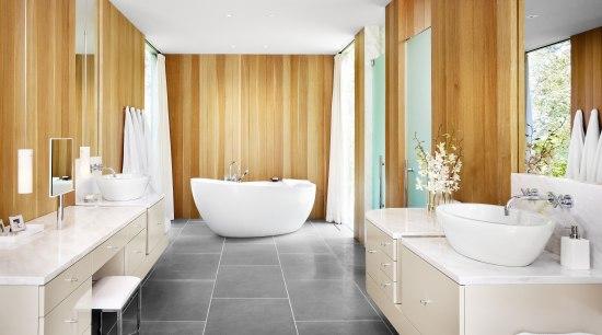 View of bathroom featuring freestanding tub, floor-to-ceiling windows, architecture, bathroom, ceiling, floor, flooring, home, interior design, plumbing fixture, real estate, room, suite, white