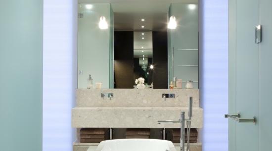 View of bathroom featuring a freestanding tub in bathroom, ceiling, countertop, floor, flooring, glass, interior design, room, sink, gray