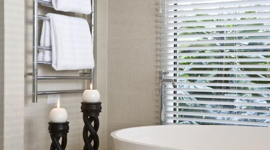 View of light-toned contemporary bathroom with white free bathroom, bathroom accessory, ceramic, curtain, floor, flooring, interior design, plumbing fixture, product design, room, tap, tile, window, window covering, window treatment, gray