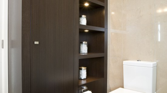 View of a bathroom desiged by a Yellow bathroom, bathroom accessory, bathroom cabinet, cabinetry, interior design, plumbing fixture, room, gray