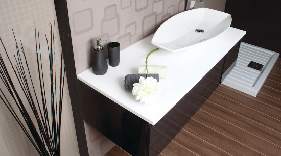 View of a bathroom which features solid-surface countertops angle, bathroom, bathroom sink, ceramic, floor, furniture, interior design, plumbing fixture, product design, sink, table, tap, gray, black
