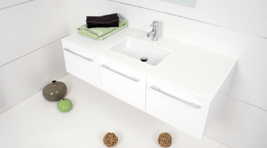 View of a bathroom which features a wall-hung bathroom, bathroom accessory, bathroom cabinet, bathroom sink, drawer, furniture, plumbing fixture, product design, sink, tap, white