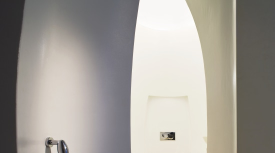 View of a powder room with an egg-shape light fixture, lighting, product design, gray, white
