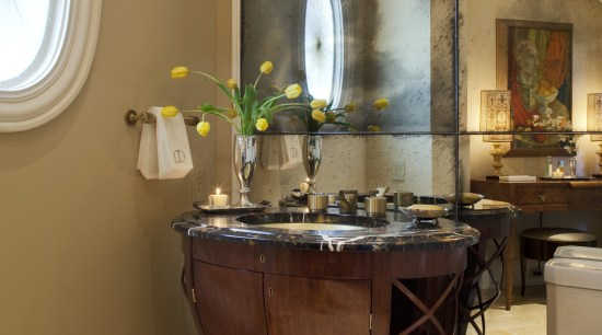 View of a powder room which features a bathroom, ceiling, furniture, home, interior design, room, table, brown