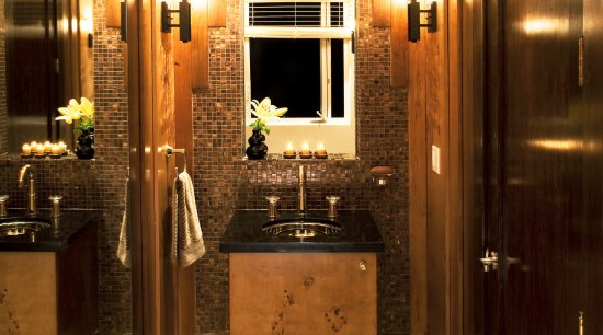 View of a powder room which features a bathroom, ceiling, home, interior design, lighting, room, brown, orange