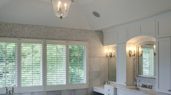 View of a Roman-styled bathroom which features a bathroom, ceiling, daylighting, estate, floor, flooring, home, interior design, light fixture, lighting, real estate, room, tile, gray