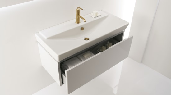 View of a Kohler basin with gold faucets bathroom, bathroom accessory, bathroom cabinet, bathroom sink, ceramic, drawer, plumbing fixture, product design, sink, tap, white