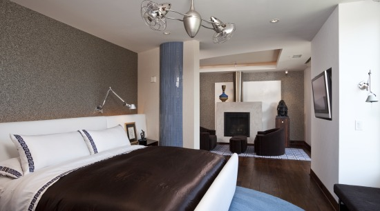 View of the master bedroom which features a bedroom, ceiling, home, interior design, property, real estate, room, suite, wall, gray