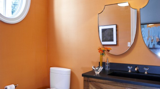 Interior view of this unique bathroom featuring curved architecture, bathroom, ceiling, daylighting, floor, home, house, interior design, orange, room, suite, table, wall, brown