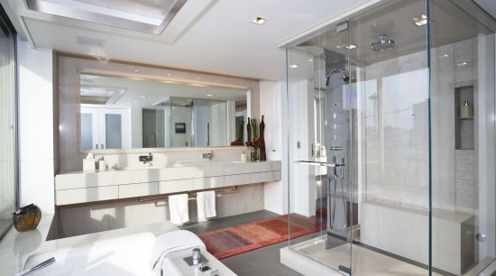 View of a bathroom which features glass shower bathroom, interior design, real estate, room, window, gray, white