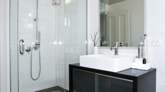 White subway tiles and Atlantis EasyTile frameless glass bathroom, bathroom accessory, bathroom cabinet, floor, interior design, room, sink, tile, gray, white