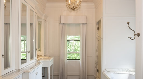 View of the master bathroom which features a ceiling, estate, floor, flooring, home, interior design, molding, room, wall, window, gray, orange