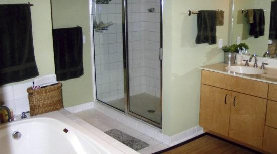 View of bathroom prior to renovations. bathroom, bathroom accessory, bathtub, floor, flooring, home, interior design, plumbing fixture, property, room, tile, window, gray