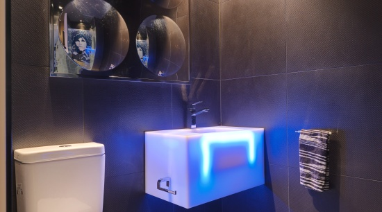 View of a themed bathroom with feature wall bathroom, ceiling, interior design, lighting, room, black