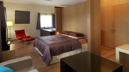 View of contemporary bedroom with wooden flooring and bedroom, interior design, real estate, room, suite, brown