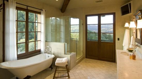 View of the bathroom with tiled floors & bathroom, ceiling, estate, floor, flooring, home, interior design, real estate, room, window, brown
