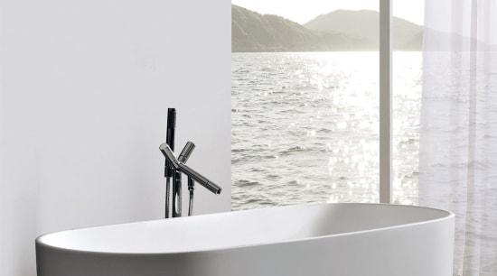 View of this contemporary bathroom angle, bathroom, bathroom sink, bathtub, ceramic, interior design, plumbing fixture, product, product design, tap, white