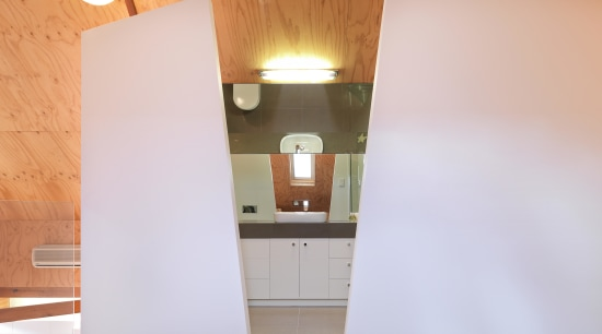 View of bathroom suite with angled openings architecture, ceiling, daylighting, floor, home, house, interior design, property, real estate, room, wall, wood, white, orange