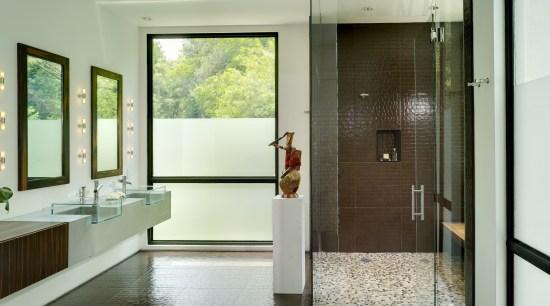 View of bathroom with brown wall and floor bathroom, door, floor, flooring, interior design, room, gray