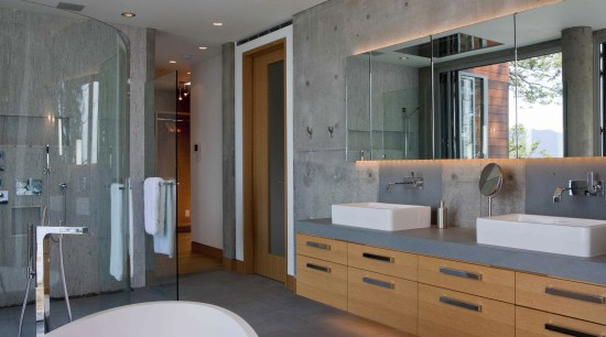 This master suite makes use of the sea bathroom, cabinetry, countertop, home, interior design, room, gray