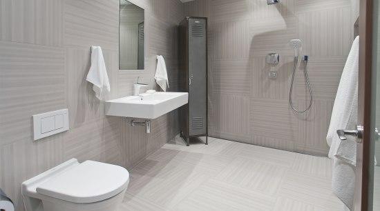 This bathroom was the winner of the small bathroom, floor, interior design, plumbing fixture, product design, room, tile, toilet, toilet seat, gray