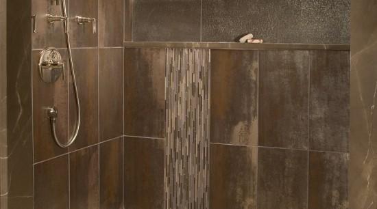 View of bathroom with brown wall tiles and bathroom, floor, flooring, plumbing fixture, shower, tile, wood, brown