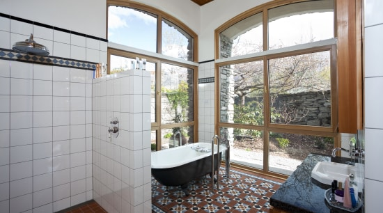 Bathroom with floor mat, free standing pub and bathroom, daylighting, estate, home, house, property, real estate, room, window, gray, white