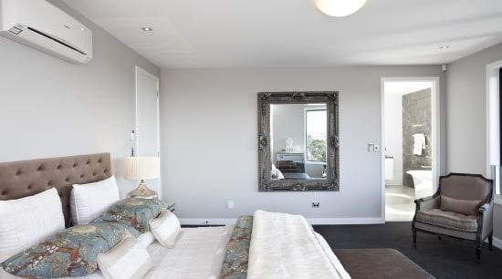 A dark charcoal-gray carpet established the color palette floor, interior design, living room, real estate, room, gray, white