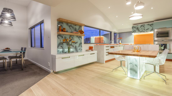 This kitchen was designed and built by Mal ceiling, floor, flooring, interior design, real estate, gray, orange