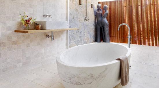 Limestone walls and floors and a wooden shelf bathroom, bathtub, ceramic, floor, flooring, interior design, plumbing fixture, product design, property, room, tap, tile, wall, gray