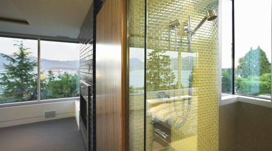 Glass mosaic tiles line the shower in this architecture, daylighting, door, glass, home, house, interior design, property, real estate, window, window covering, window treatment, brown