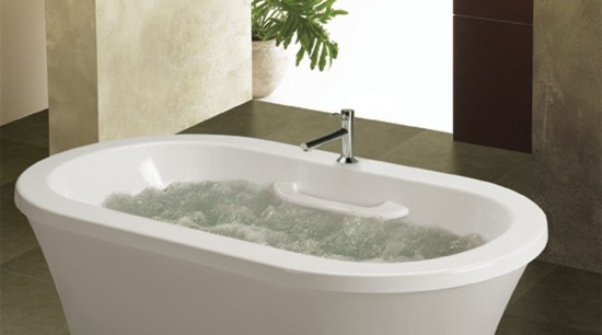 The Thermomasseur bath from Bain Ultra features Geysair bathroom, bathroom sink, bathtub, ceramic, plumbing fixture, product design, tap, toilet seat, brown, white